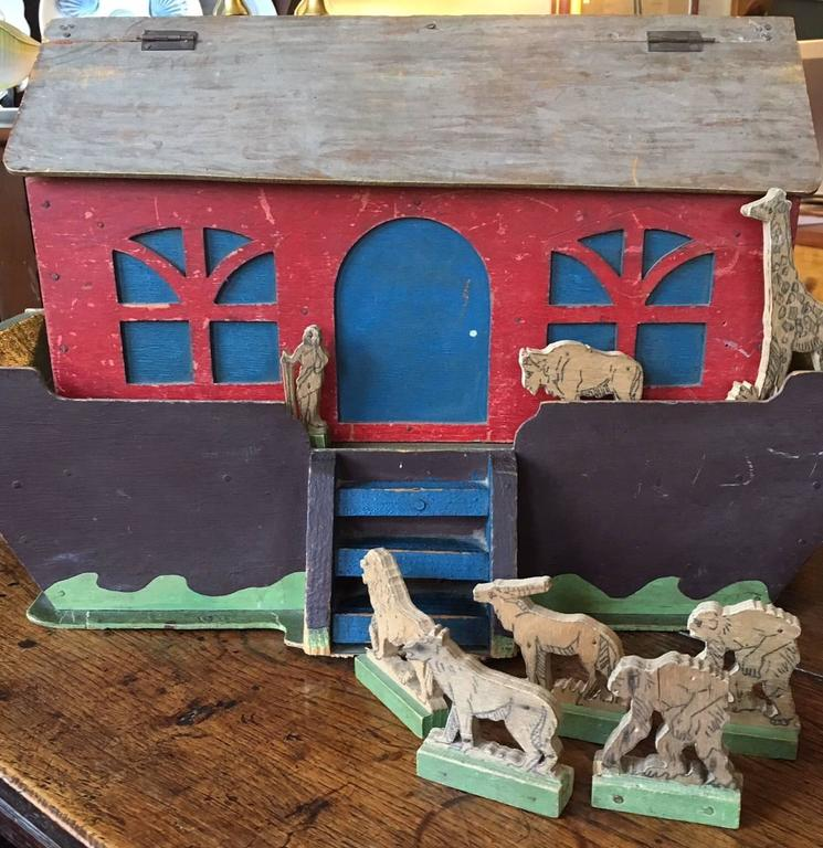 19th century handcrafted Folk Art Noah's Ark, circa 1890s with a variety of wooden figures, comprising 13 animals and Noah. Some pairs of animals, some singles. Roof of Ark is hinged for ease of storage. Old label inside indicates that this was hand