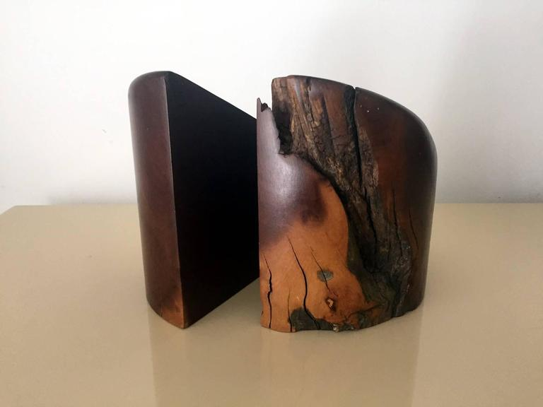 A pair of large heavy bookends designed by Don Shoemaker and made by Señal S.A. Mexico. Made from natural cocobolo, the Mexican rosewood. They feature beautiful wood grains, natural cracks, wormholes, all the imperfections that reflect beauty of