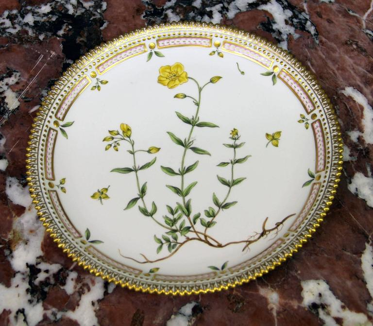 A pair of 20th century Flora Danica round platters.  Finely decorated with gold accent designs, reticulated rims and