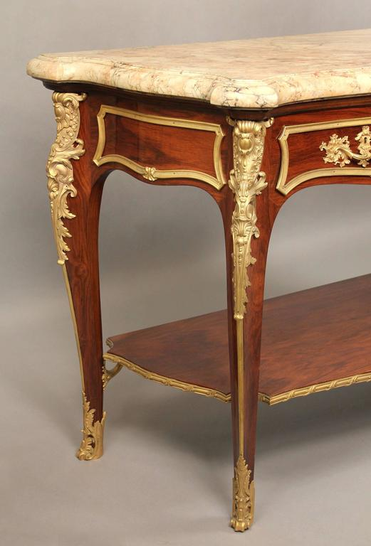 An extremely fine late 19th century Louis XV style gilt bronze-mounted server or console.