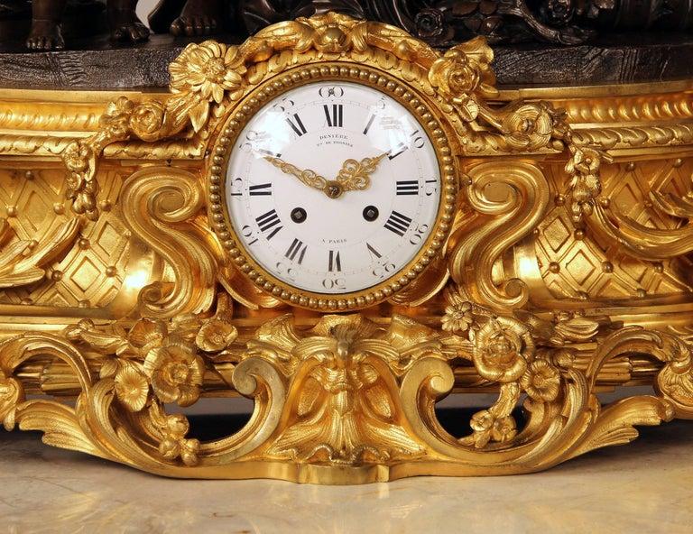 Belle Époque Exceptional Late 19th Century Gilt and Patinated Bronze Figural Clock by Denière For Sale
