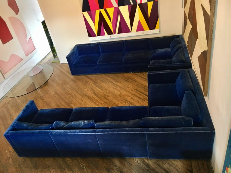 """Sectional sofa designed by Charles Pfister for Knoll, upholstered in a deep ultramarine velvet.   Can be used in vintage condition or upholstered for an additional fee.  It consists of two two-seat sections 68"""" wide and two three-seat"""