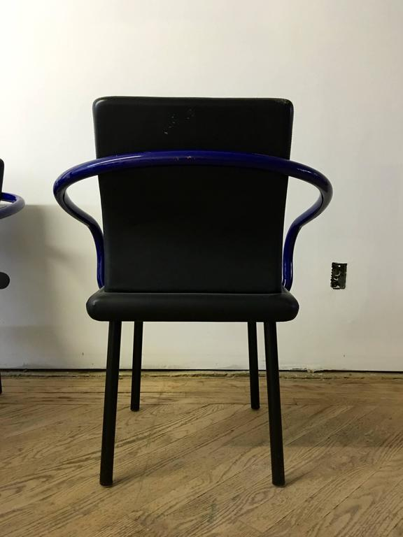 Set of six Mandarin chairs with original black leather upholstery and blue enamel arms, designed by Ettore Sottsass for Knoll International in 1986.