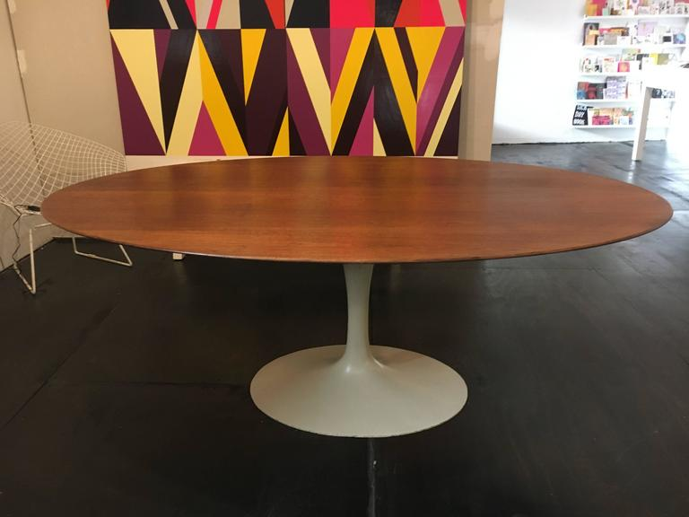 Oval Tulip Table Designed By Eero Saarinen For Knoll. Walnut Top And Cast  Iron Base