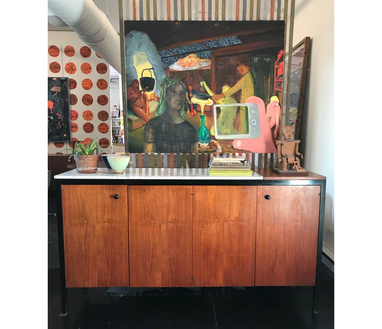 Marble-top black frame group double buffet designed by George Nelson for Herman Miller in 1959. Four doors enclosing four shallow pull-out trays and two adjustable shelves. Lift lid enclosing hot plate. These cabinets are some of the rarest and most