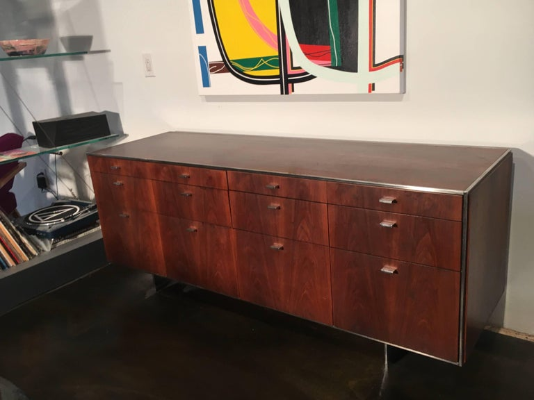 Credenza designed by Davis Allen, made by GF, circa 1968. Walnut with chrome base and pulls, lock on the left side.