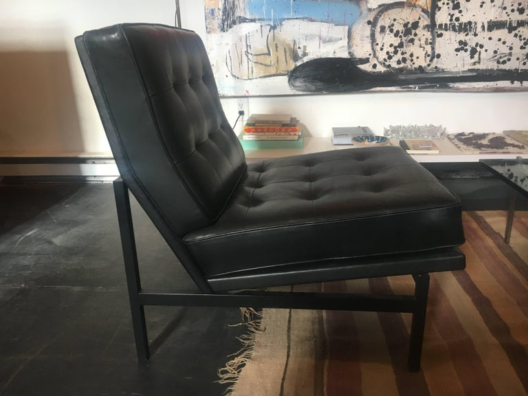 Pair of black leather parallel bar chairs with rare original black bases. Designed by Florence Knoll, circa 1958.