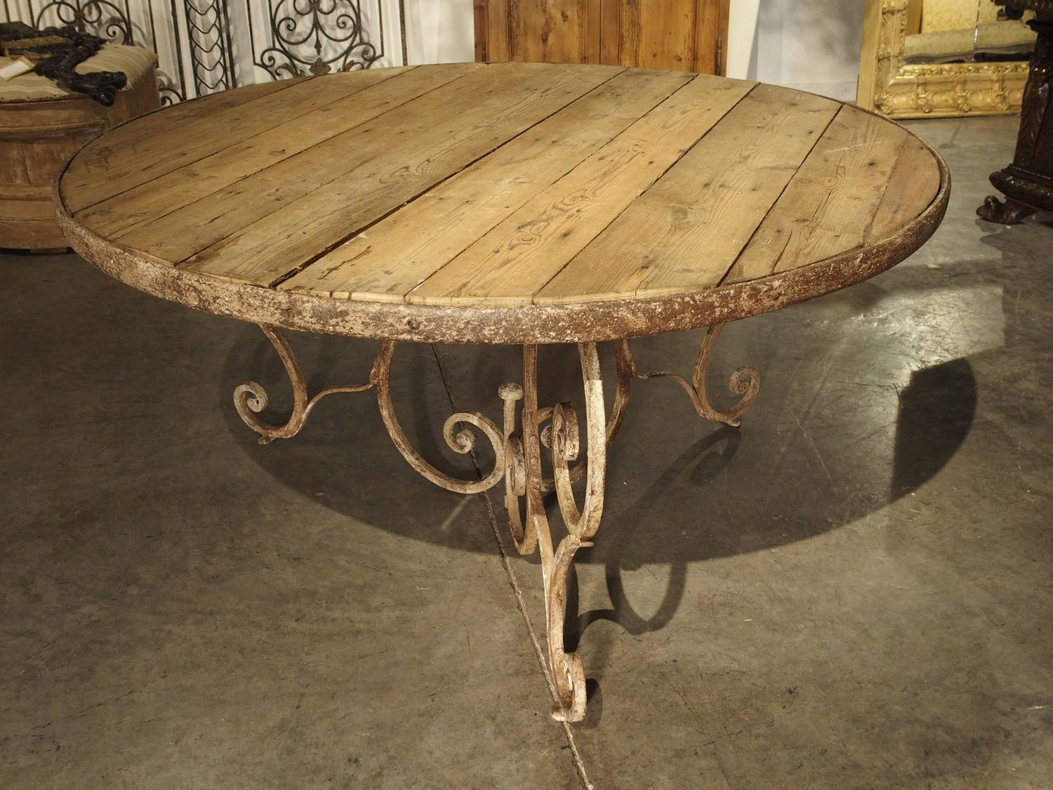 round wooden top dining table with 19th century iron base