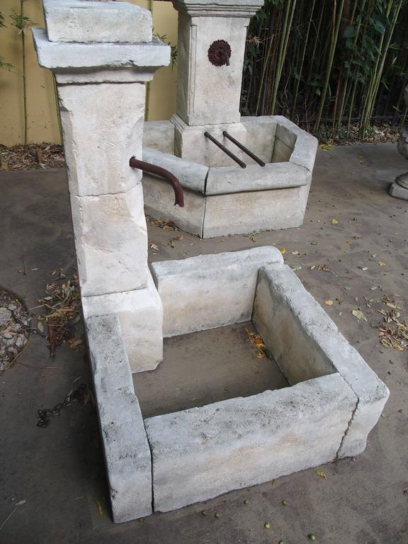 This is a hand-carved fountain from France. It is made in Estaillade limestone, with a soft natural color patina added to stone along with distressed markings. This one is quite unique in that it can be free standing or placed directly into a