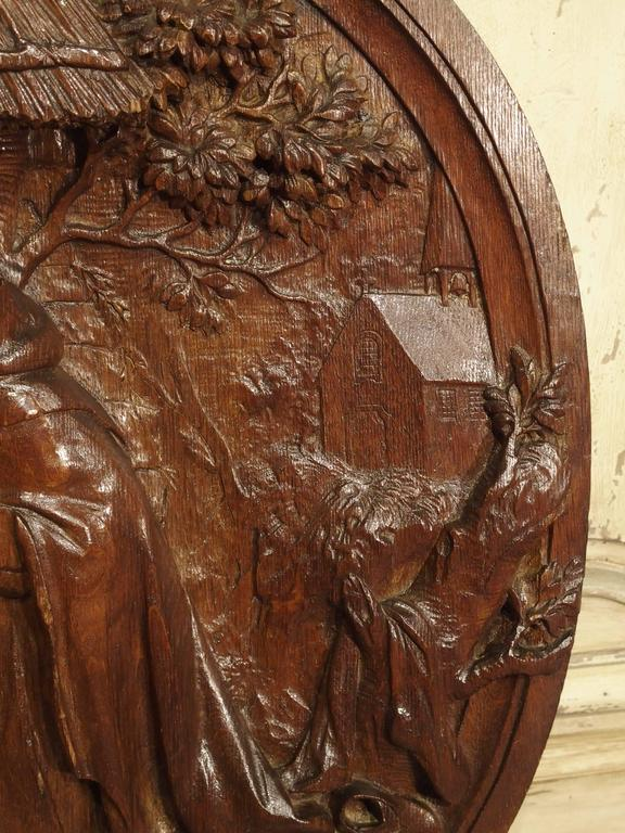 This beautiful hand-carved French wooden plaque dates to the 1700s. It depicts a very finely executed scene of a religious nature with varying degrees of symbolism. Originally this may have been in a Church or a private chapel of a chateau. This