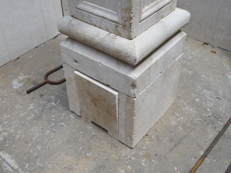 This beautiful French centre fountain from Provence has been hand-carved and distressed out of Estaillade limestone. The centre post has a ball finial, while four sides having recessed panels with stylized ogee moldings. The ball portion can be left