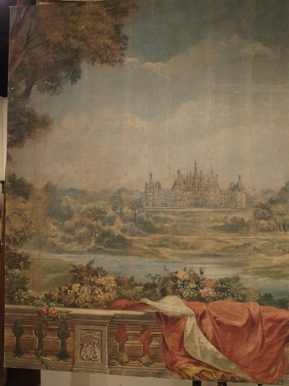 This large antique French painting is a depiction of one of the most famous Chateaux in France. This magnificent piece is just over 7 feet high (as is), and close to 9.5 feet wide. Chateau Chambord was originally built in the 16th century and is the