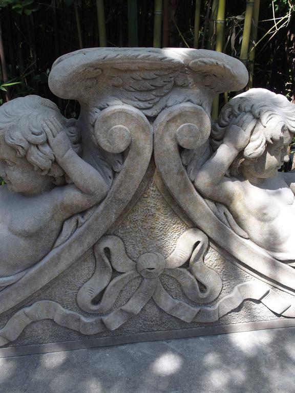 Contemporary Winged Cherubs Carved Limestone Garden Bench from Italy For Sale
