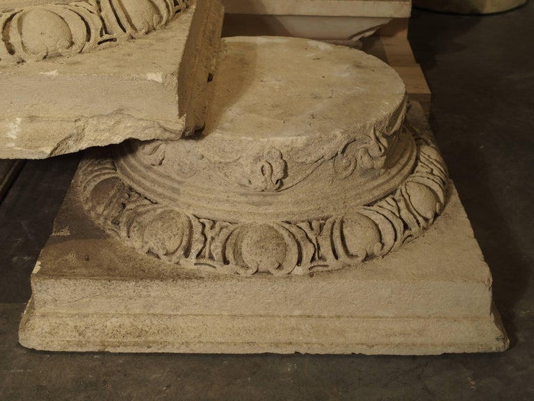 These stunning antique French stone column capitals or bases were recently salvaged from a property near Beauvais, France. Their age is estimated to be from the early 1800s. The stones have motifs of scrolling rinceau and stepped out egg and dart