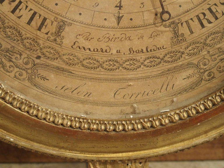 This rare barometer is known as a Selon de Torricelli and dates to the late 18th century. This name refers to the mechanism invented by Italian physicist Evangelista Torricelli over 100 years earlier. It is giltwood with motifs of the laurel leaf