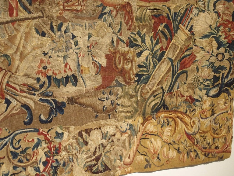 This is a large, horizontal fragment of a late 17th century Beauvais tapestry. Beauvais tapestry manufacture was one of the most well-known tapestry workshops in France. Beauvais was a private enterprise which made glorious tapestries at the special