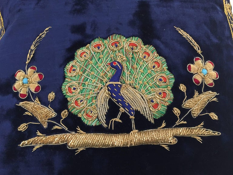 Velvet midnight blue silk pillow hand embroidered with gold threads and sequins depicting a royal peacock on a branch. Gold, green, indigo blue and ruby red with turquoise pearl. One of a kind handcrafted throw pillow. Silk backed with zipper.