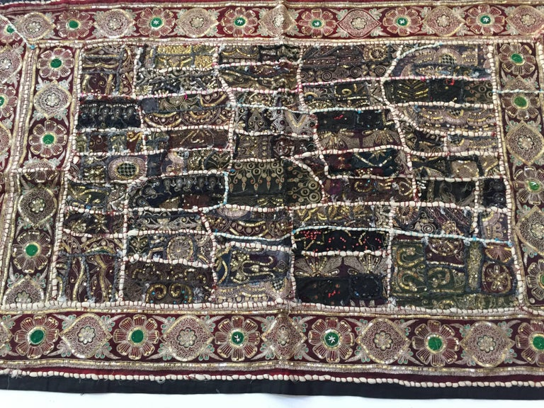 Hand embroidered and quilted textile from India.  Backed with black linen.  Fanciful Asian folk designs this distinctive quilt work is a true sense of artistic freedom.  The majority of the border is comprised of alternating vintage floral