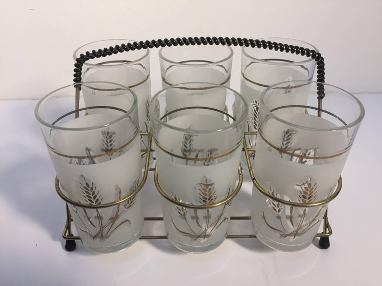 Set of six midcentury vintage drinking glasses in frosted glass with wheat gold design. Set of six drinking tall glasses in brass cart with black accent design on handle and foot. Made in Italy for Covetro, circa 1960s. Glasses are: 2.75