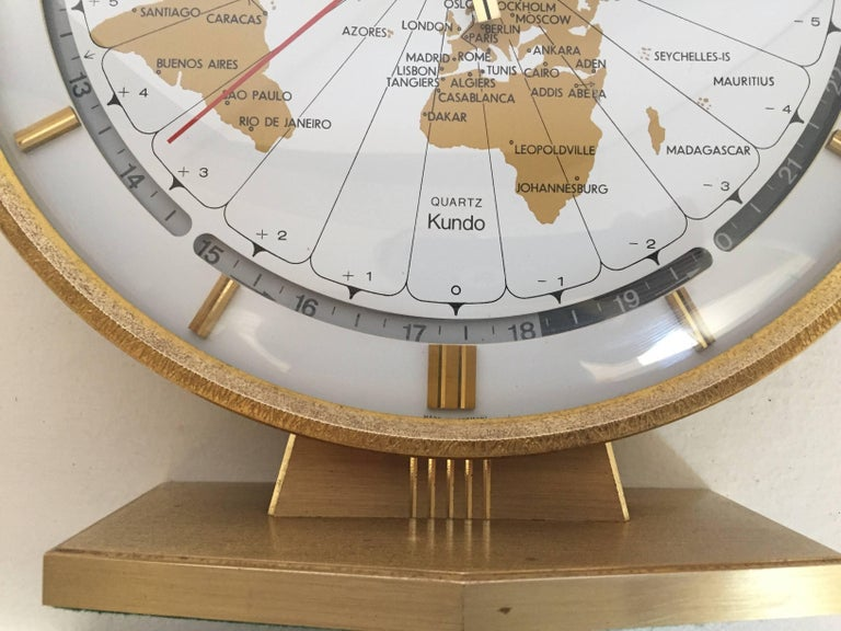 Large Kieninger & Obergfell modernist table world timer zone clock, 1960s Unique brass round world clock by Kundo Automatic made in West Germany, circa 1960s. Wonderful round clock with large 9