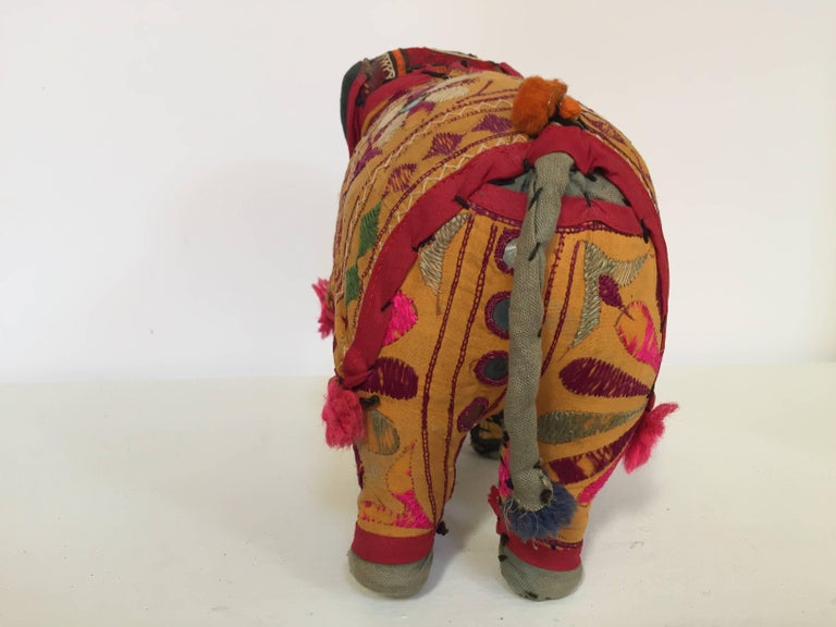 Handmade in Rajasthan, India, colorful fabric elephant toy. Vintage small elephant stuffed cotton embroidered and decorated with small mirrors, great collector piece. Anglo Raj, small stuffed elephant wearing the ceremonial folk attire made from