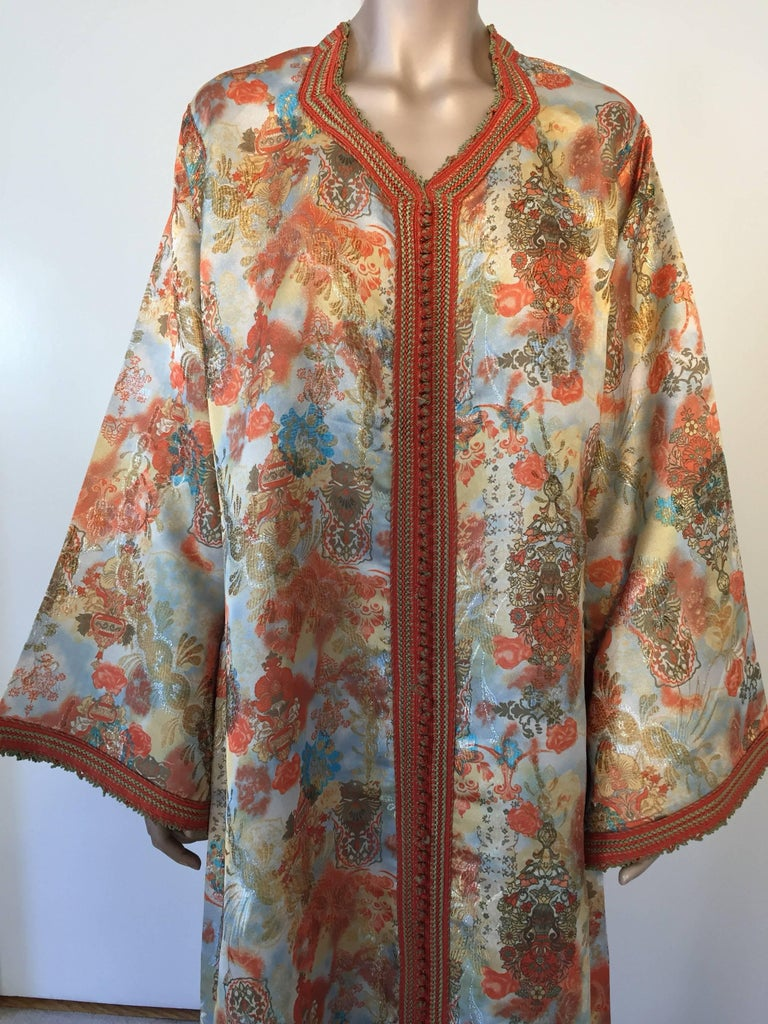 Gorgeous vintage hostess gown, floral multicolored brocade Kaftan, circa 1970s. Exotic oriental floral long maxi caftan dress with wide arm and long sleeves in shimmering brocade fabric. This Kaftan speaks for itself with its rich vibrant colors in