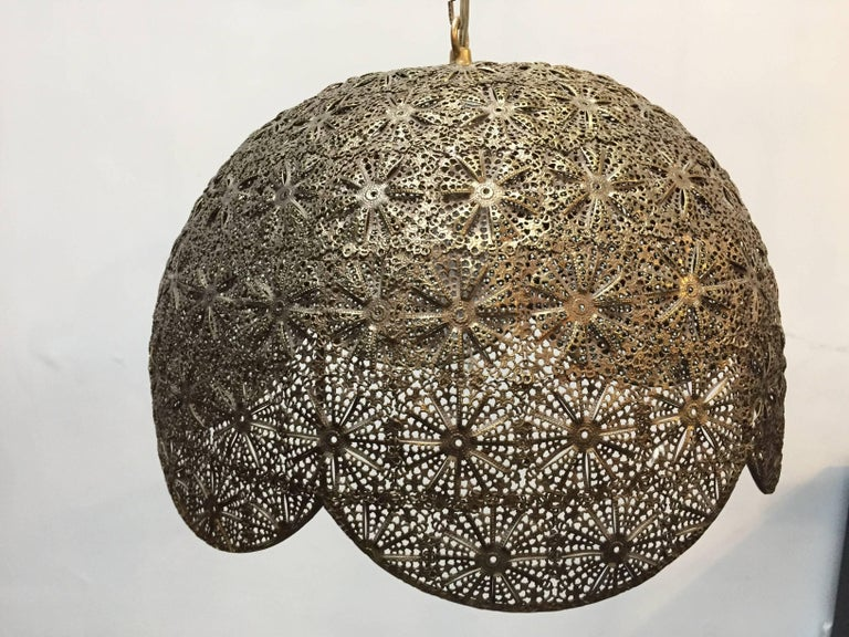 Moorish, Middle Eastern Syrian filigree pierced brass hanging lamp. Unique ceiling fixture finely handcrafted in brass repousse with nice geometric Moorish filigree floral designs. Rewired for electricity with one light bulb. Moroccan style