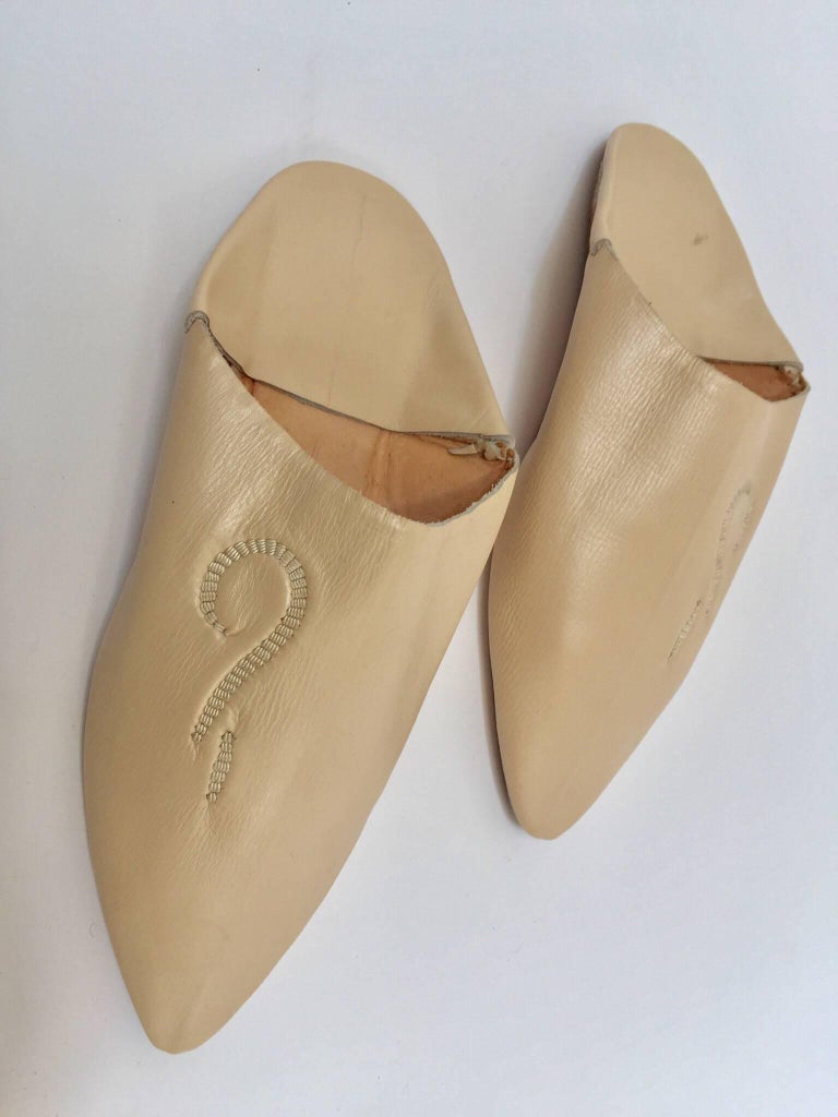 Moroccan leather slippers are handmade to perfection the inside sole is crafted of soft leather. Hand-sewn sole and handcrafted in Fez Morocco.  You won't want to take the Moroccan babouches off your feet. Moroccan slippers to wear around the
