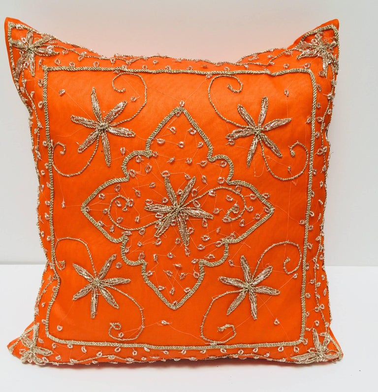 Throw decorative accent orange pillow embroidered and embellished with sequins with Moorish metallic threads, gold beads embroidery on turquoise. Handcrafted in India.