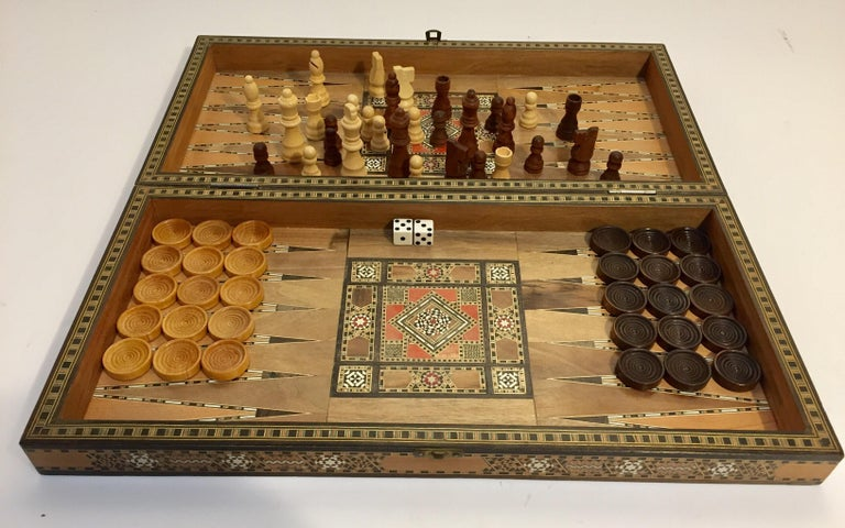 Vintage large Mid Century Syrian inlaid mosaic backgammon and chess game. Great inlaid micro mosaic hinged marquetry game box features a chess and checker board on the exterior and backgammon board on the interior with all the wooden dice and