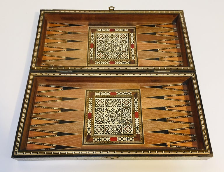 Large vintage midcentury Syrian inlaid mosaic backgammon and chess game. Great inlaid micro mosaic hinged marquetry game box features a chess and checker board on the exterior and backgammon board on the interior with all the wooden dice and