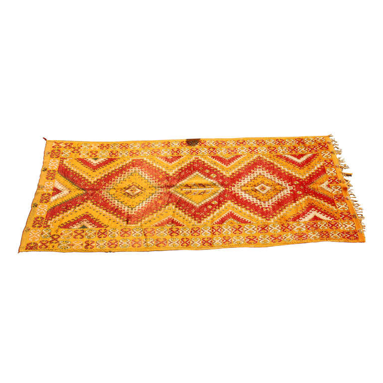 Vintage midcentury Moroccan Berber tribal African rug. This tribal carpet features a wonderful work of art in safran orange and red geometrical design, free style, amazing Moroccan tribal carpet runner. Will fit in any Bohemian, Moroccan or Modern