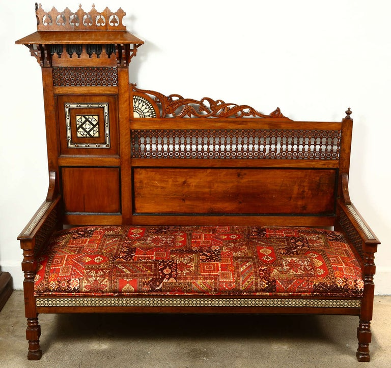 Antique 19th century Middle Eastern Moorish Syrian settee, intricate Moroccan Musharabie fretwork on the back and side, inlaid with mother-of-pearl and ebony. Hispano Moresque very unusual shape decorative sofa. Upholstered with a fabric that looks