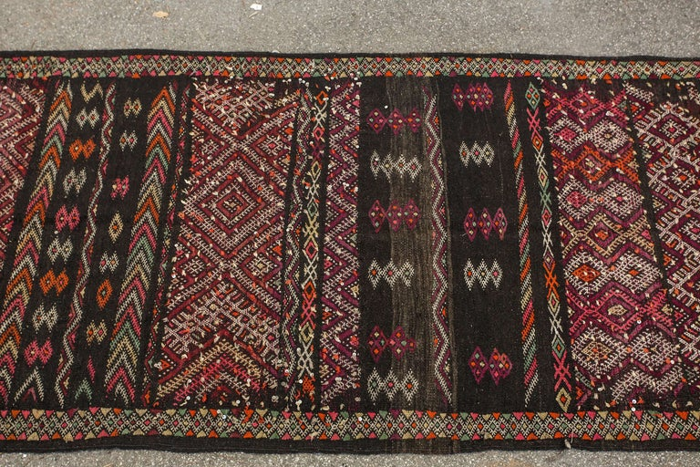 Vintage Moroccan nomadic African Tuareg rug, black camel hair with wool and cotton embroidered geometrical modernist designs.