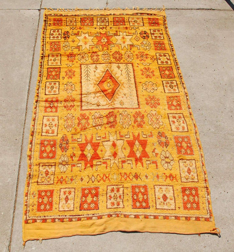 Moroccan vintage tribal rug, earth orange tone colors, handwoven by the Berber women of the Middle Atlas of Morocco. Geometrical designs, great collector pile carpet, could be used as a runner.