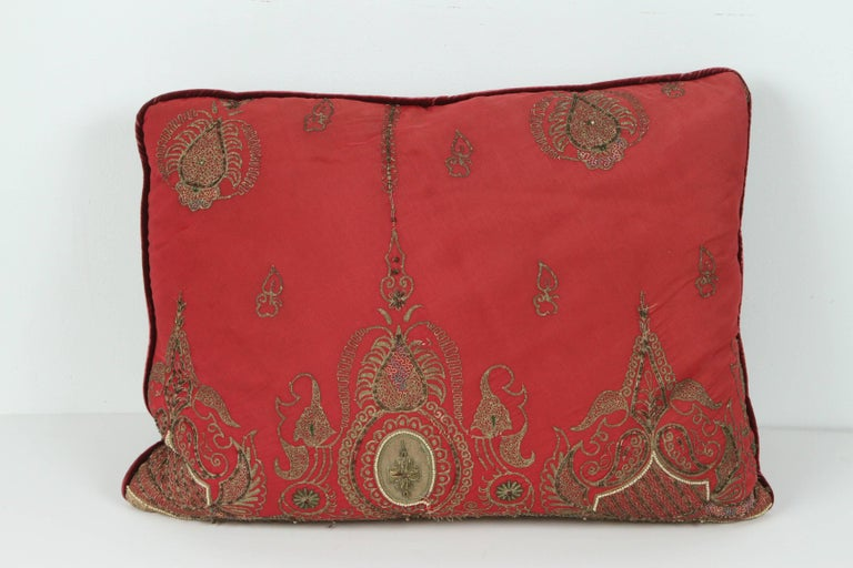 Pair of antique silk pillows with metallic threads and dark burgundy velvet backing. Pair of handmade silk pillows made from an antique 19th century Turkish silk embroidered panels with gold metallic thread and pearls. Down filled and only a pair