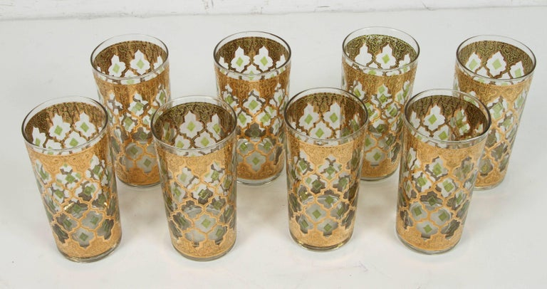 Elegant vintage midcentury Culver barware glasses with Valencia pattern in a gold leaf finish. Set includes 8 Culver highball glasses in Valencia Moorish style design. This fabulous vintage Culver set of barware with 22-carat gold decoration is