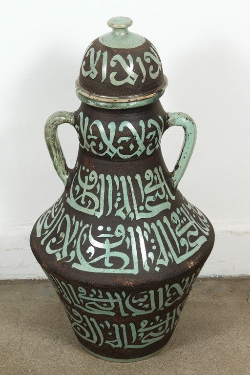 Pair of Moroccan green and brown ceramic urns with lid and handles.