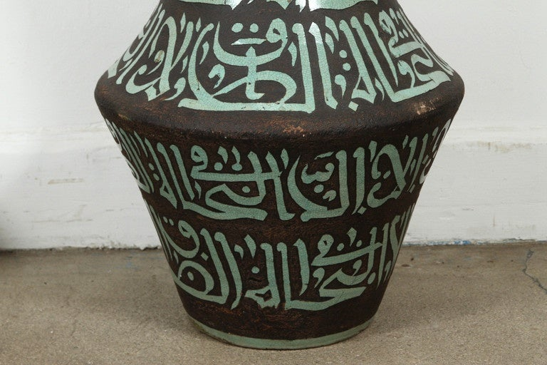 Pair of Moroccan Green and Brown Chiselled Ceramic Urns with Handles In Good Condition For Sale In Los Angeles, CA