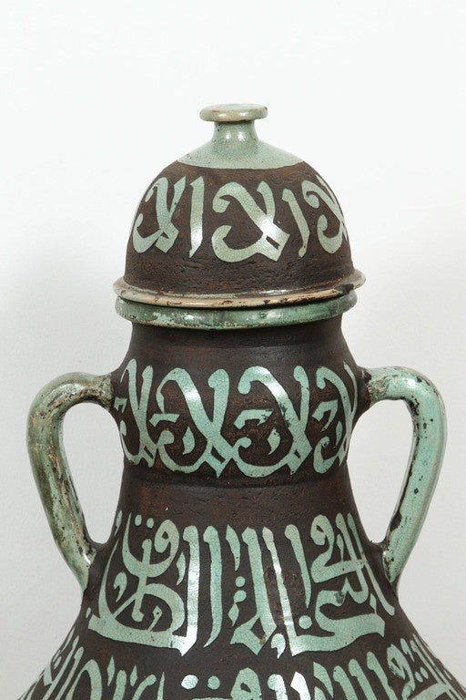 20th Century Pair of Moroccan Green and Brown Chiselled Ceramic Urns with Handles For Sale