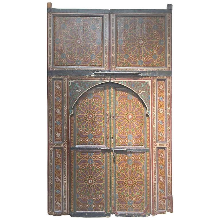 Moroccan antique door from a Ryad in Fez, amazing hand-painted artwork.  Multicolored - Moroccan Antique Double Door At 1stdibs