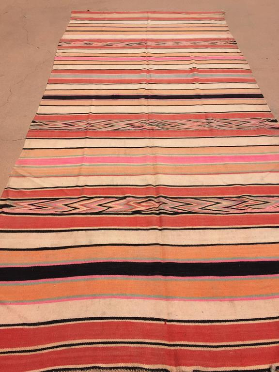 Vintage Moroccan flat-weave Kilim rug. Large size blanket vintage Moroccan rug, handwoven by Berber women in Morocco for their own use. This rug was made using flat-weave technique with linear pattern of alternating stripes in different colors in