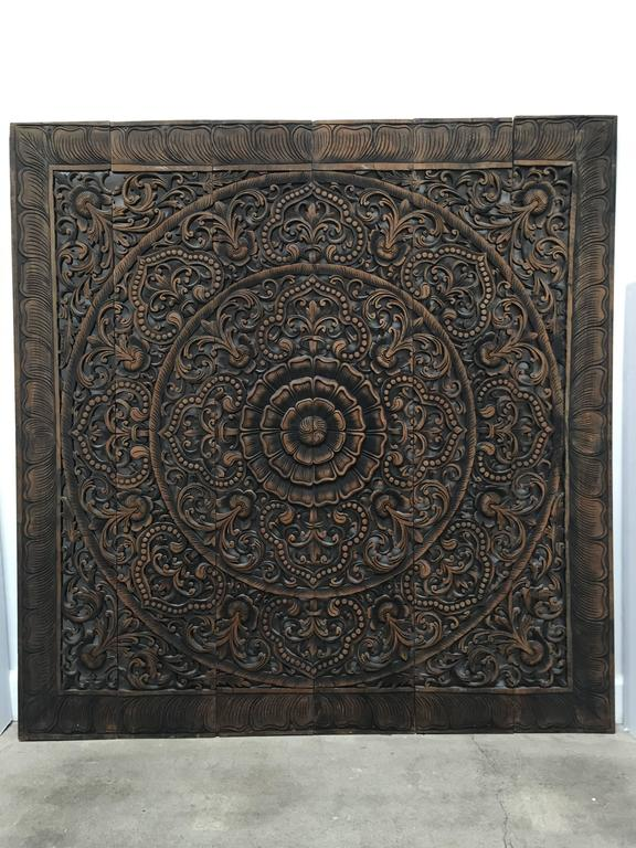 Intricately hand-carved Balinese decorative lotus wall art panel. This beautifully carved ceiling panel is made and from teak wood and features flower lotus motifs. Large oversized handcrafted teak wood in traditional intricate lotus floral