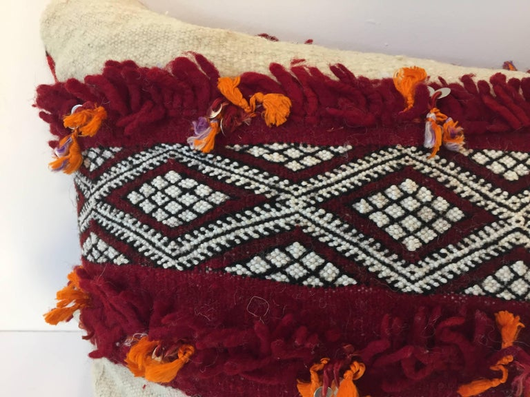 Moroccan Berber pillow white and red with geometric tribal designs. Handwoven tribal throw pillow made from a vintage flat-weave rug.  Made from Tribal Moroccan rug, he front and the back are made from a different Moroccan carpet, the front is more