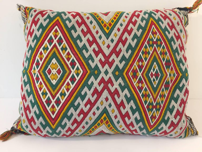 Moroccan Berber pillow red with geometric tribal designs. Handwoven tribal throw pillow made from a vintage flat-weave rug. The front and the back are made from a different rug, front is more elaborate and back is burnt orange. Handwoven by