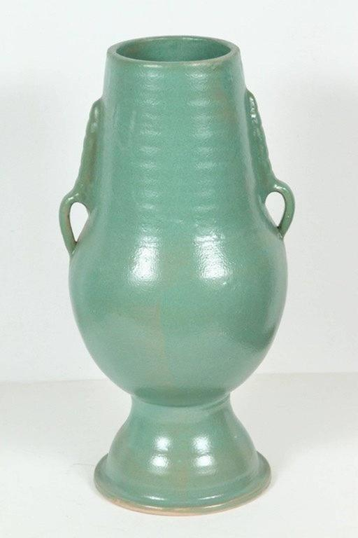 Footed Moroccan turquoise (teal) color handcrafted ceramic vase with handle. Great modern form and elegant lines. Work with modern or Classic interiors. Size: 22 in H. 12 in Diameter for the widest part. Top: 6.25 in. D. Bottom diameter : 8.5