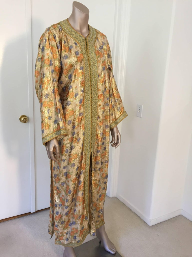 Elegant Moroccan caftan floral brocade embroidered with gold trim, circa 1970s.  This long maxi dress kaftan is embroidered and embellished entirely by hand.  One of a kind evening Moroccan Middle Eastern hostess gown.  The kaftan gown features a