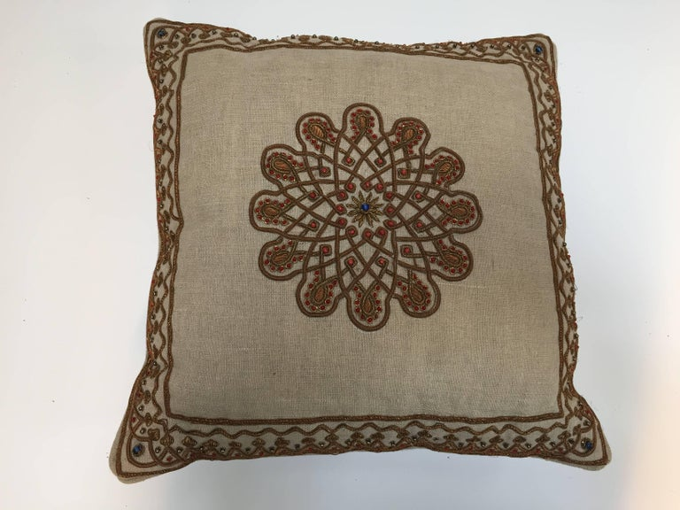 Throw decorative accent pillow embroidered with Moorish metallic threads embroidery on tan color linen. Handcrafted pillow embellished with Turkish metallic threads embroidered onto linen and embellished with red beads. Down inserts.