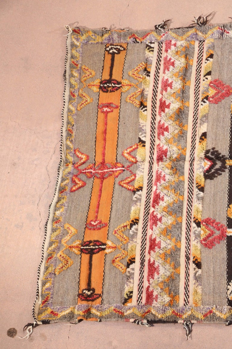 Midcentury Moroccan vintage tribal rugs handwoven by Berber women in Morocco.