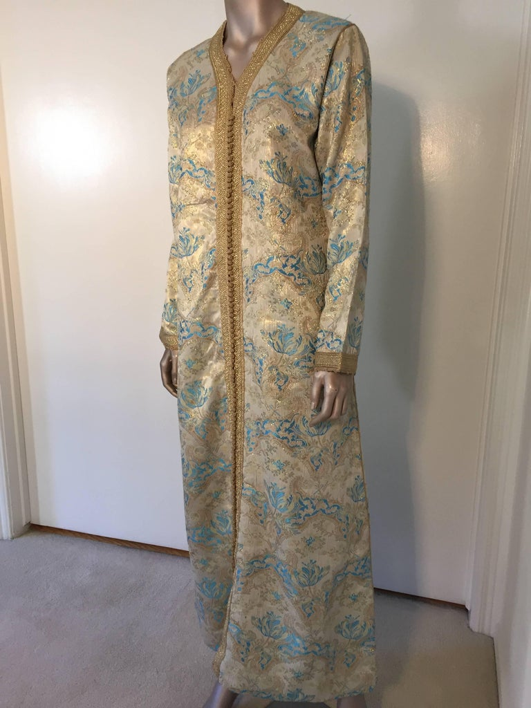 Elegant Moroccan caftan gold and aquamarine blue metallic gorgeous vintage hostess gown.  Floral multi-colored brocade Kaftan circa 1970s. Exotic oriental floral long maxi caftan dress with long sleeves in shimmering brocade gold and aquamarine blue